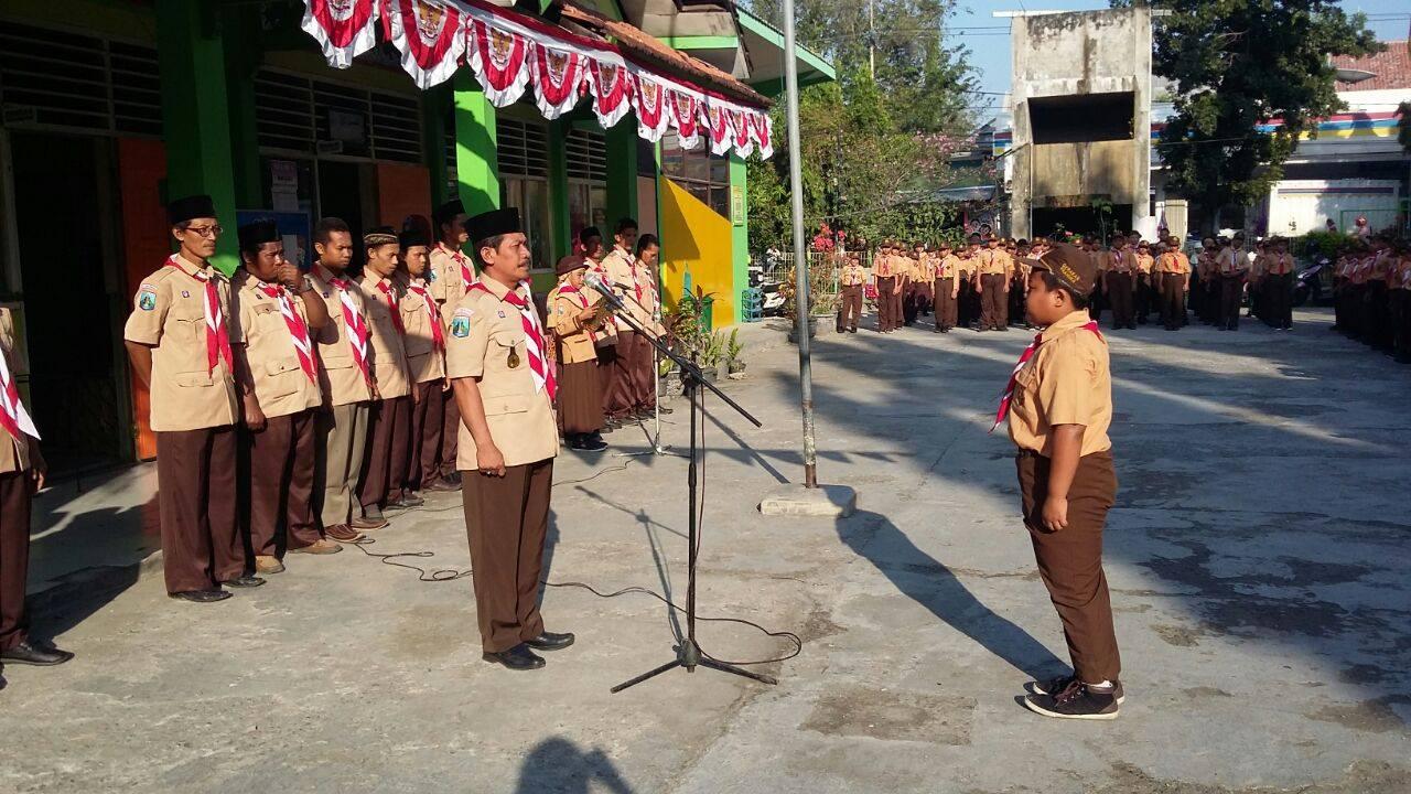 Laporan Pemimpin upacara kepada kakak Kamabigus